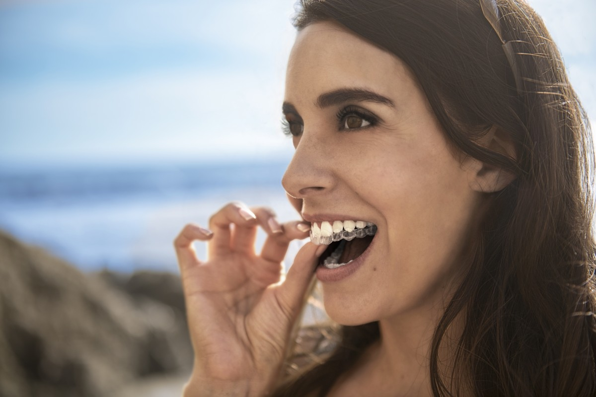 Women using Invisalign teeth straightening dental product